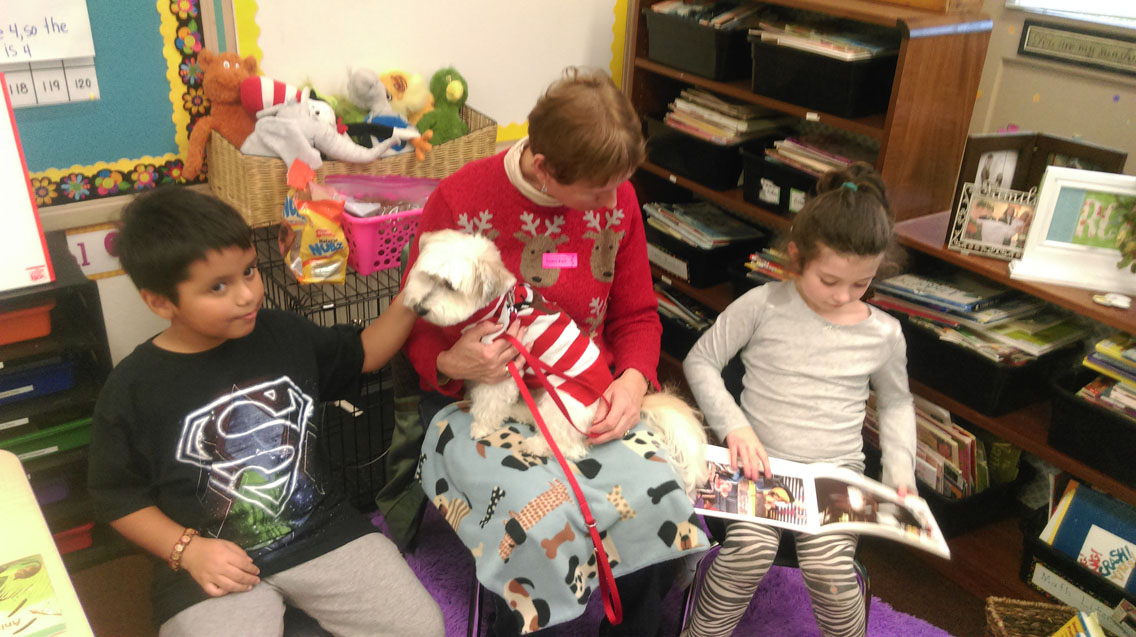 A reading dog visits Sunrise Elementary School for storytime.